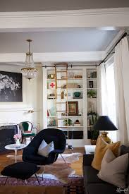 the beautiful library ladder has a twin and i can t wait to do a similar version of these built ins in our house for her to glide on someday