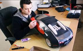 The cardboard bugatti chiron looks very crude, but the team has done a commendable job once the project is complete, the cardboard bugatti chiron gets taken for a test drive through residential. Video Finds Build Your Own Paper Veyron Behind The Scenes Of The Porcelain Bugatti