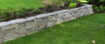 a stone wall could be part of your landscaping project or you could just want to make a more interesting boundary wall a decorative stone wall can really