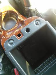removing gmc envoy center console w aux input install gmtnation 1b now you can remove the arm rest to make it easier to get to the connector and bolts inside the center console and easier to remove it too its just