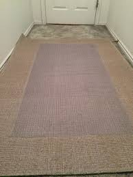 rug over carpet. next, place the vinyl runner upside down and center it on area rug. rug over carpet