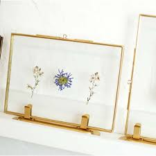 cool gold standing picture frame with pressed flowers in