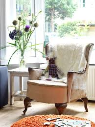 stuffed chairs living room using antique wingback armchair with white fur throw blanket aside small rustic