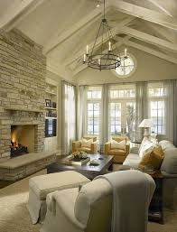 chunky jute rugs | vaulted ceiling, stone fireplace flanked by built-ins, TV