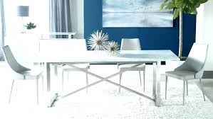 white marble round dining table black and top