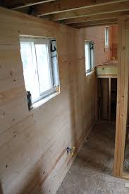 tiny house pine board tongue and groove planking in kitchen