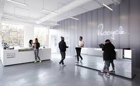 rocycle boutique fitness studio by xml mirrored reception desk translucent wall