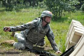 u s department of defense photo essay  u s army spc derek a michael takes a quick look over an obstacle before