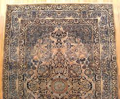 hand knotted antique persian lavar oriental rug in small size with medallion corner