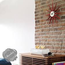 vitra nelson red sunburst wall clock by george nelson