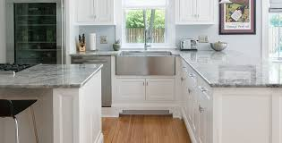 light pours in from everywhere suffusing the blue gray walls and variegated gray countertops