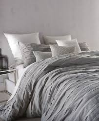 a textured look brings stylish modern appeal to the loft stripe cotton voile queen duvet cover from dkny polyester cotton machine washable imported