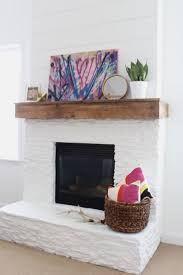 white painted stone shiplap fireplace makeover