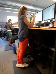 tableau employees christina house and natalie graham stand at their desks rather than sit