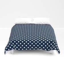 dark blue background with white polka dots duvet cover