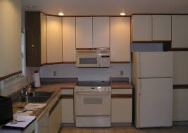 painting particle board kitchen cabinets new how to update metal kitchen cabinets 22 year old kitchen