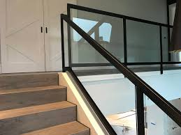 glass panels used to infill a tubular steel railing