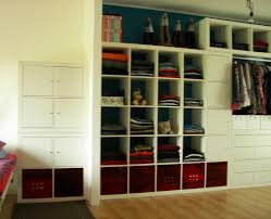 furniture white wooden closet with racks and red shoe storage connected by brown wooden floor