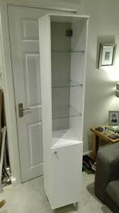 ikea fullen tall white bathroom cabinet with glass shelving