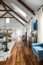 Handsome Living Room With Wood Floors And Foxy Roof Design