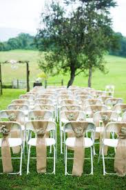 Chelsa Yoder Photography. DIY Vintage Barn Wedding. Ceremony chair decor,  excellent way to hide ugly folding chairs! | The BEST day ever!
