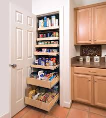 kitchen storage cabinet in white made of wood with pull out shelves