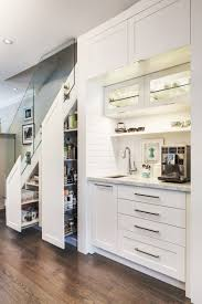 Ideal This home added a coffee station and food storage cabinet under the  stairs