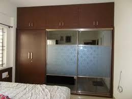 modern bedroom wardrobe loft glass sliding door service provider from chennai