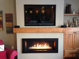 functional gas fireplace installation for flat walls with closed hearth and flat tv installation on top in modern kitchen