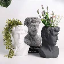 david flower pot garden statues