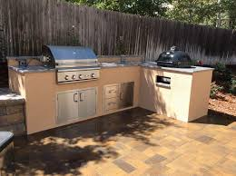 affordable outdoor kitchen in englewood co with granite countertops stucco finish kommado smoker stainless natural gas grill