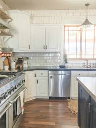 diy farmhouse kitchen remodel featuring stainless steel appliances white subway tiles open shelving