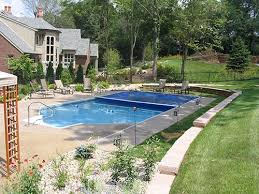 automatic pool covers all safe pool fence covers blue automatic pool cover covering an in ground swimming pool out a fence