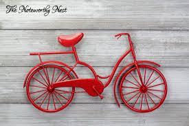 red metal bicycle wall art