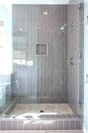 bathroom dark grey subway tile pale