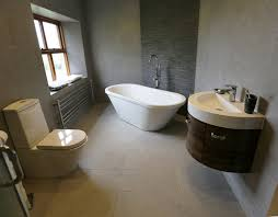 sink bathroom stand alone bath slate tile feature behind tub walnut curved sink