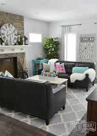 a traditional black and white living room with pops of bright