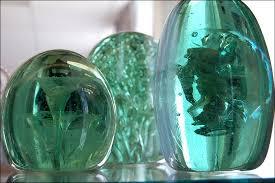 green glass doorstops
