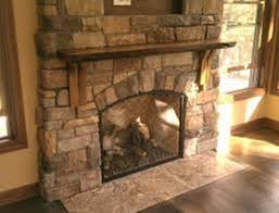 stone reclaimed wood fireplace mantel