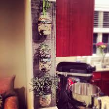 how to make a wall mounted mason jar planter runningtothekitchen com