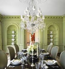 pistachio green dining room with chandelier