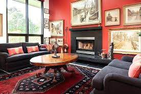 red living room rugs beautiful framed wall art and the bold rug steal the show here red living room rugs