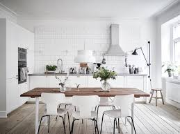 View in gallery Small and stylish Scandinavian kitchen with breakfast nook  and floating wooden shelves [Design: Studio