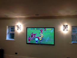 we have mounted this huge 70 inch sharp tv on the wall in the cinema room