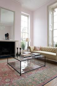 a black framed glass coffee table makes this vintage living room more modern