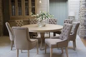 round dining table with upholstered chairs