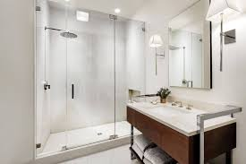 cleaning tips for your bathroom glass shower doors with wall sconces and frameless door