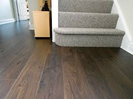 laminate finished up to a carpet my er installed i have also cut it walnut flooring