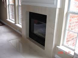 black marble fireplace surround and brown leather upholstered and marble fireplace surround