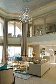 high ceilings living room chandelier high ceiling living room beach style with wrought iron railing tray